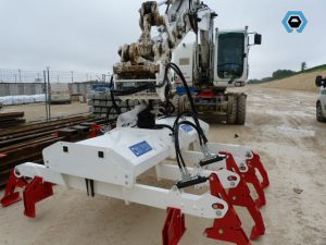 Palonnier hydraulique pour la manutention de traverses